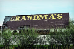 Grandmas. An old abandoned building with Grandma`s written on the roof with yellow paint Stock Photography