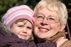 Grandmather and granddaughter in park Stock Images