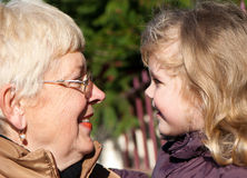 Grandmather and granddaughter in park Stock Photos
