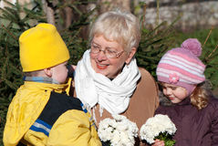 Grandmather and grandsons in park Stock Photography