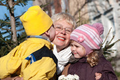 Grandmather and grandsons in park Stock Photo