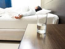 Grandmom sleeping in weakness concept, focus on glass Royalty Free Stock Photos