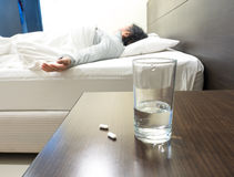 Grandmom sleeping in weakness concept, focus on medicine and gla Royalty Free Stock Photography