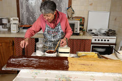 Grandmother. A grandmother who prepares the french Yule log Royalty Free Stock Photos