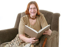 Grandmother. Looking photo album in sofa Royalty Free Stock Image