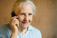 Grandmother. Happy grandmother talking on cell phone Royalty Free Stock Images