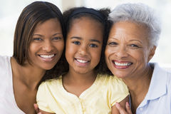 Grandmother with adult daughter and grandchild. Smiling Stock Photography