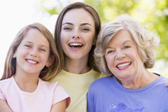 Grandmother with adult daughter and grandchild Royalty Free Stock Images