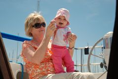 Grandmother And Baby On A Sailboat Royalty Free Stock Photo