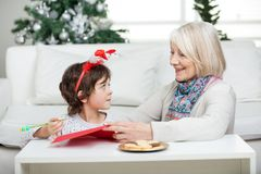 Grandmother Assisting Boy In Writing Letter To Royalty Free Stock Photo