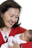 Grandmother and baby Stock Images