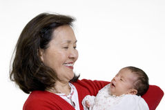 Grandmother and baby. A proud grandmother hold her new granddaughter for the first time Stock Images