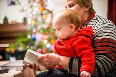 Grandmother with her baby. Grandmother with baby boy, happy love moment together Royalty Free Stock Photo