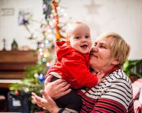 Christmas family. Grandmother with baby boy, happy love moment together, monochrome Stock Image