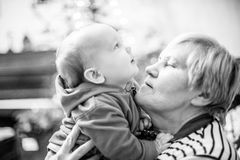 Grandmother and grandson infant. Grandmother with baby boy, happy love moment together, monochrome Royalty Free Stock Image
