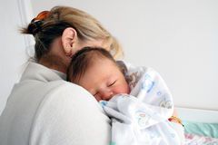 Grandmother and baby(colour) Stock Images