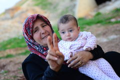 Grandmother with baby. They are illegaly in Turkey. They escaped from Syria to Turkey because of civil war Stock Images