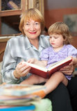Grandmother and baby reading book Royalty Free Stock Photo