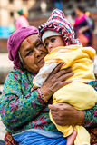 Grandmother and baby. Relaxing in Durbar square, Kathmandu, Nepal Stock Image