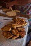 Grandmother bakes pies Stock Photos