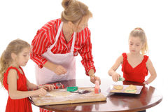Grandmother baking cookies with children. Isolated on white Stock Image