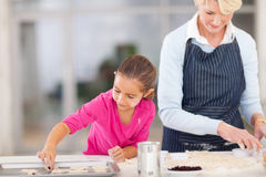 Grandmother baking cookies Royalty Free Stock Images