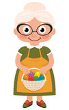 Grandmother with a basket of Easter eggs Royalty Free Stock Photography