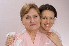 Grandmother and beautiful granddaughter Stock Photos