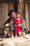 A grandmother Black Dao ethnic. A grandmother Dao black with his grandchildren. Here we see the difference of costume between the grandmother and grandchildren Stock Images