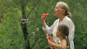 Grandmother Blowing Soap Bubbles stock video
