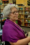 Grandmother at the book store Royalty Free Stock Image