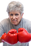 Grandmother and boxing gloves Royalty Free Stock Photography