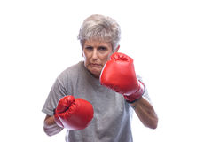 Grandmother with boxing gloves Royalty Free Stock Photo