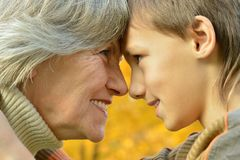 Grandmother with boy Stock Images
