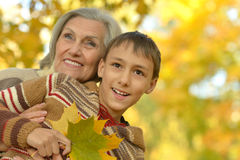 Grandmother with boy  in  park Stock Photos