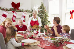Free Grandmother Bringing Out Turkey At Family Christmas Meal Royalty Free Stock Photography - 62735637