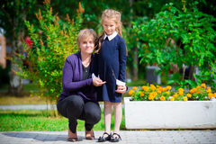 Grandmother brings her granddaughter to school. Adorable little girl feeling very excited about going back to school Royalty Free Stock Photos