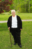 Grandmother with cane. Elderly woman walking with cane because of arthritis stock photography