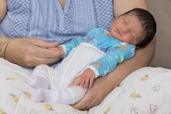 Grandmother caring a newborn baby. Sleeping baby Royalty Free Stock Photo
