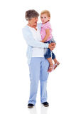 Grandmother carrying grandchild. Full length portrait of grandmother carrying her grandchild isolated on white Royalty Free Stock Photo