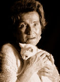 Grandmother and cat Royalty Free Stock Photos