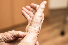Grandmother checking pulse on wrist Stock Photos