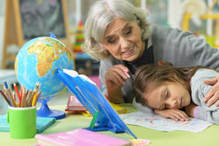 Grandmother and child drawing Stock Images