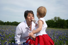 Grandmother and Child in Flower Field Stock Photo