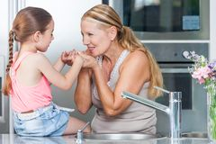 Grandmother and child girl cooking home kitchen. Grandmother and child girl cooking at home kitchen Royalty Free Stock Photos