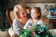 Grandmother with child preparing for Christmas Stock Photos