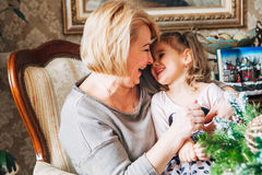 Grandmother with child preparing for Christmas Stock Photography