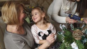 Grandmother with child preparing for Christmas stock video