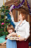 Grandmother and child preparing for  Christmas Royalty Free Stock Images