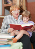 Grandmother and child reading  book together Royalty Free Stock Photos